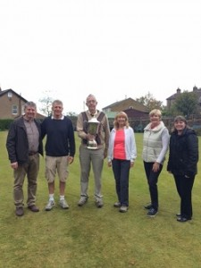 Presidents day winners 2017, Lynn and John receive the trophy from In as Gregg and Trisha our Sponsors from Ainsworths look on.